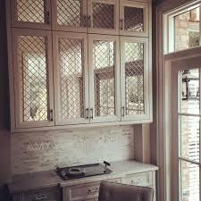 amy vermillion interiors antique mirror behind nickel wire