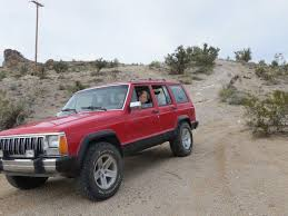 lifted jeep cherokee jacked up adding ground clearance with a skyjacker 3 inch lift