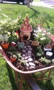 wheel barrel fairy garden we got the idea and began collecting