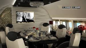 interior cool private jet dining room with mounted tv screen and