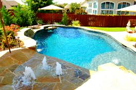 another stunning example of a freeform pool with tequila table and