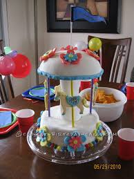 cool homemade 3d carousel cake with fondant decorations