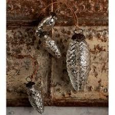 silver pinecone ornament on onekingslane mercury glass