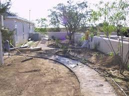 Southwest Landscape Design by Building Garden Flower Beds And Walkways