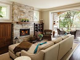 living room with stacked stone fireplace tan sofa built in
