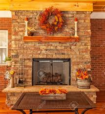covered backyard deck at residential house with gas fireplace