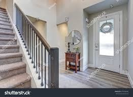 White Grey Laminate Flooring Grey Foyer Laminate Flooring High Ceiling Stock Photo 578769946