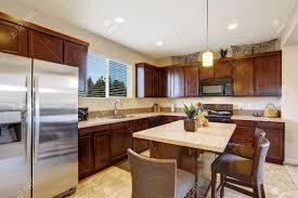 modern kitchen room with kitchen island and stools dark brown