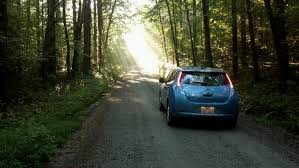 nissan leaf yellow warning light nissan leaf ev renewable energy dirt road blue water leaf