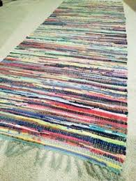 this chindi rug is made of fabric remnants loomed by weavers in