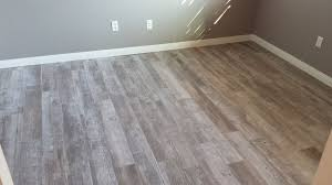 porcelain tile made to look like a wood floor small 16 inch grout