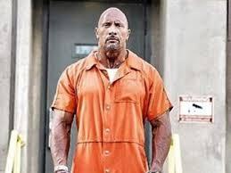 orange jumpsuit dwayne johnson wears orange jumpsuit on sets of fast and furious 8