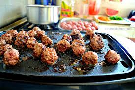 Two Meatballs In A Kitchen by Meatball Tikka Masala