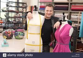 designer kretschmer fashion designer guido kretschmer poses between two dress