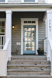 turquoise door white trim and grey siding shingle siding would