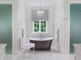 tiered crystal chandelier over tub flanked br frosted glass his