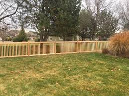 consider a custom wood fence for your home