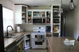 How To Paint Your Kitchen Cabinets Like A Professional How To Spray Paint Cabinets Like The Pros Bright Green Door
