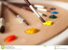 Paint Pallet by Tubes With Oil Paint Lying On Canvas And Pallet Stock Photo