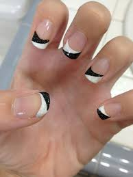 a very quirky french tip including a white and black combination