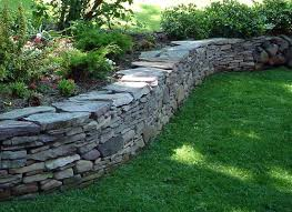 how to add stone features in your backyard without destroying