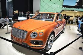 orange bentley bentayga bentley bentayga shot down at the ring automotorblog