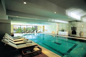 Lounge Chairs In Pool Design Ideas Awesome White Brow Wood Glass Modern Design Indoor Pool Ideas Wall