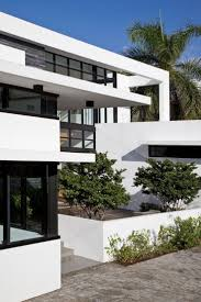mnmmod terrace outdoor dining modern home in golden beach florida