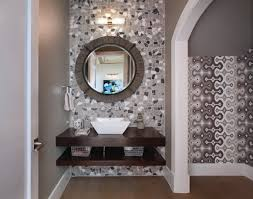 the powder room and guest bathroom features a circular mirror with the powder room and guest bathroom features a circular mirror with wooden border a grey grey wallpaperwallpaper ideascircular