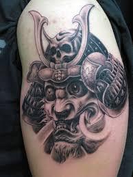 samurai helmet blossoms and cloud tattoos on full chest photo 2
