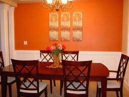 dining room orange painted wall with chandelier ideas with brown