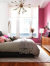 pink wall color for cherry red wooden floor for small bedroom