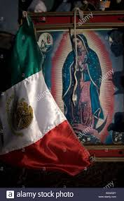 Guadalupe Flag A Mexican Flag Decorates An Image Of The Our Lady Of Guadalupe In