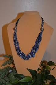 ladder ribbon necklace with ladder ribbon yarn one strand is pulled from