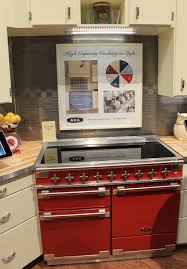 aga colorful ranges and a retro kitchen at kbis retro renovation