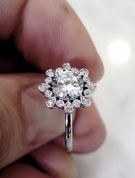 unique engagement ring fleurette unique diamond halo with deco details in white gold