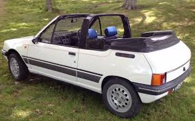 peugeot convertible curbside capsule 1989 peugeot 205 convertible u2013 fun in the sun or