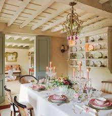 inviting shabby chic dining room with candles and flower vase as