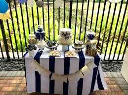 fancy boy baby shower navy gold and white tablecloth is from
