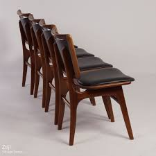 vintage four vintage teak dining chairs with black imitation