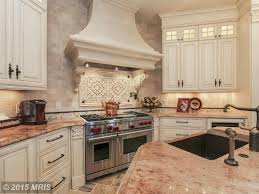 traditional kitchen with stone tile by nabila altafullah zillow