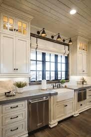 white kitchen cabinets with antique brown granite 10 antique white kitchen cabinets that jazz your kitchen up