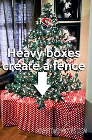 help with christmas creating a faux gift fence around your christmas tree to help keep