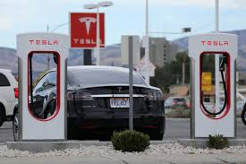 tesla charging tesla reaffirms effort to build cars in china mum on deal report