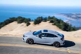 honda civic crowned top car 2017 honda civic hatchback sport touring top side in motion