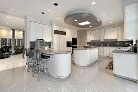 white kitchen with two islands in luxury home stock photo picture