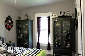 nice white wall movie room decor that has black cabinet can add