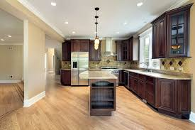 kitchens with wood floors and cabinets railing stairs and