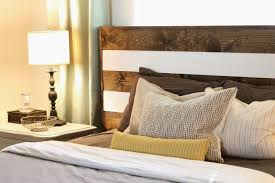bedroom tall mosaic reclaimed wooden headboard in modern rustic dark natural walnut wooden bed with white stripe and vintage table lamp on white nightstand