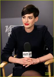 pixie haircut stories anne hathaway dons demure dress before showing off quirky gloves